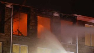 Firefighters in Fall River, Massachusetts respond to an early morning blaze Monday, Jan. 12, 2020 at a mill building.
