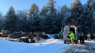 Authorities respond to a multi-car crash that involved dozens of vehicles on Tuesday, Jan. 7, 2020 in Carmel, Maine.