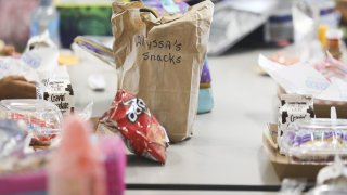 student lunches sit on a table in a Florida cafeteria