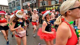 Runners start the race, making their way down Boylston Street during the 20th Annual Santa Speedo Run in Boston on Dec. 14, 2019.