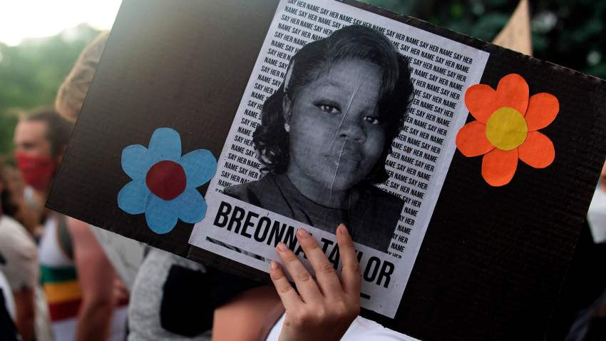 In this June 3, 2020, file photo, a demonstrator holds a sign with the image of Breonna Taylor, a Black woman who was fatally shot by Louisville Metro Police Department officers, during a protest against the death George Floyd, in Denver.