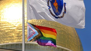 A new transgender flag is hoisted at the Massachusetts State House in Boston