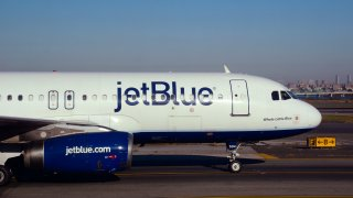 A JetBlue passenger jet taxis at LaGuardia Airport in New York