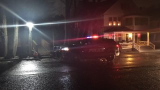 Police car in front of house off missing child in Ansonia connecticut