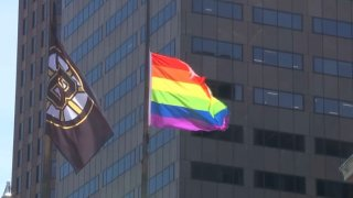 boston pride 2019 pride flag and bruins flag at city hall