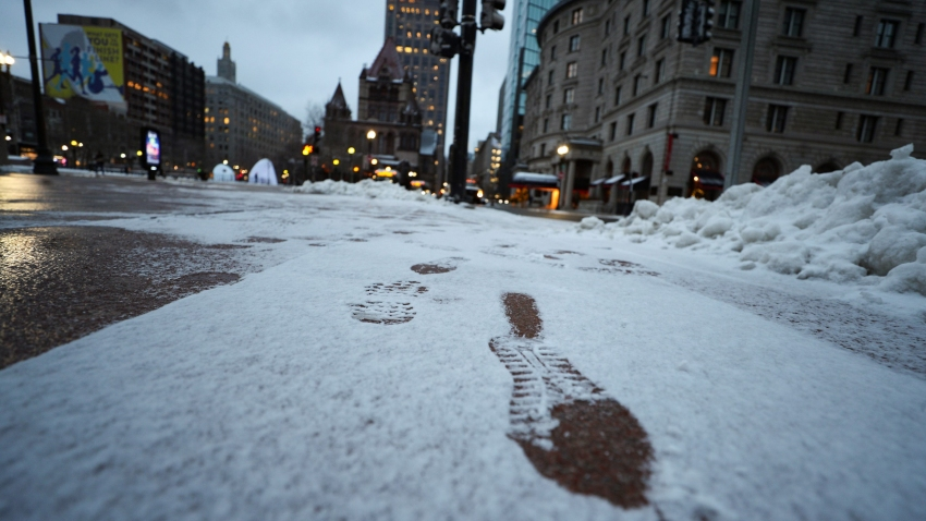 Footprints seen in downtown Boston on Wednesday, Dec. 18, 2019.