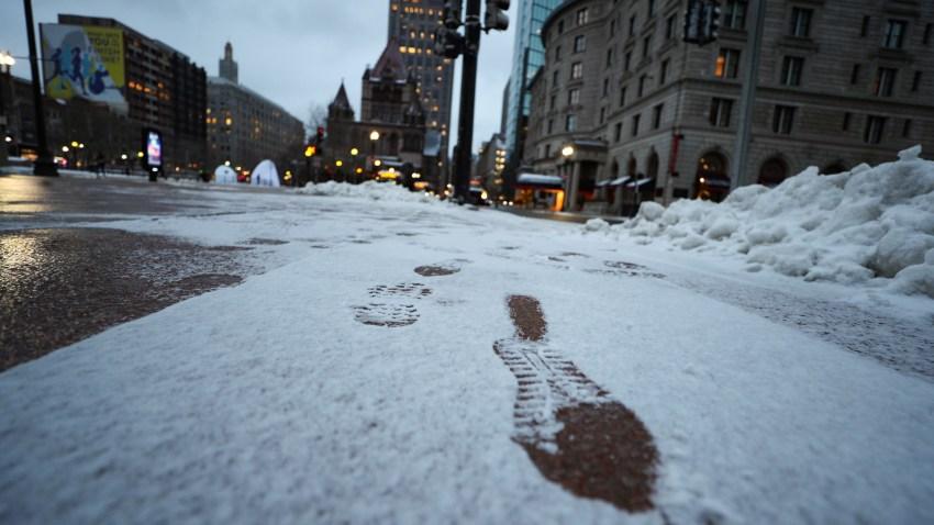 Footprints seen in downtown Boston on Wednesday, Dec. 18, 2019.
