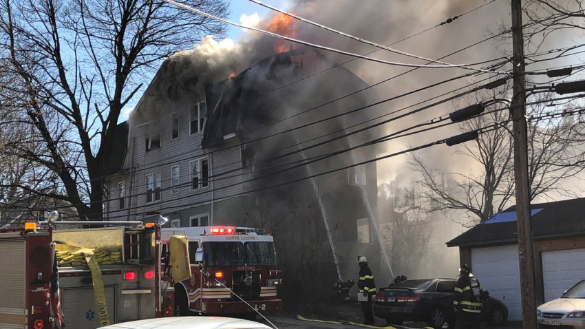 flames shoot from a 3-story home in Hartford