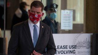 Boston Mayor Marty Walsh wears a Patriots mask amid the coronavirus crisis