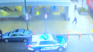 Still image from surveillance video of the Feb. 7 shooting outside Brigham and Women's Hospital in Boston