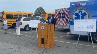The mayor of Revere, Massachusetts, speaks about the coronavirus pandemic in front of ambulances.
