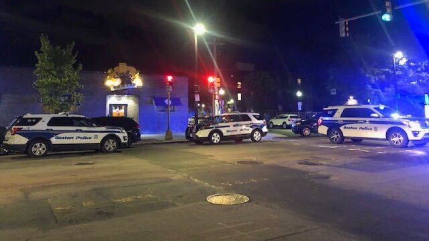 Boston police cruisers at the scene of a shooting in Roxbury