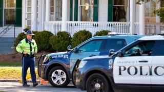 A state trooper outside the Swampscott home of Massachusetts Gov. Charlie Baker