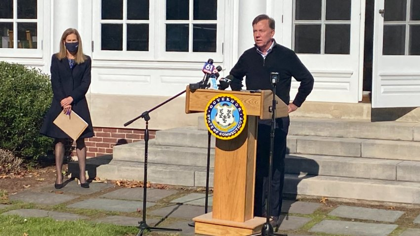 governor Ned Lamont standing outside his residence in Hartford.