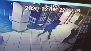 A still from surveillance video showing a man throw a vase at a hotel worker in Manchester, New Hampshire