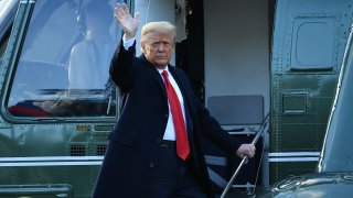 Outgoing President Donald Trump waves as he boards Marine One at the White House in Washington, DC, on January 20, 2021. - President Trump travels his Mar-a-Lago golf club residence in Palm Beach, Florida, and will not attend the inauguration for President-elect Joe Biden.