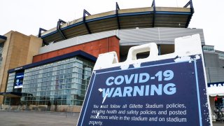 A COVID-19 warning and prevention message is seen outside Gillette Stadium before a game between the New England Patriots and the New York Jets on Sunday, Jan. 3, 2021.