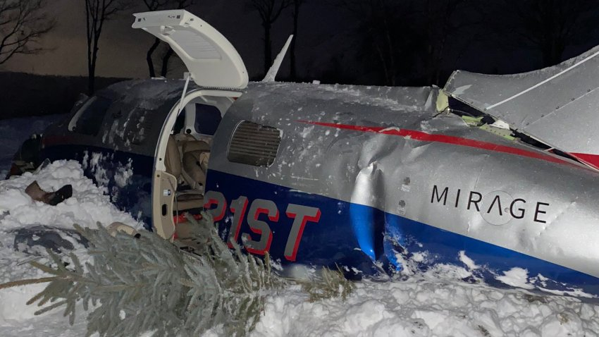 A crashed plane in Leicester, Massachusetts, on Tuesday, Feb. 2, 2021.