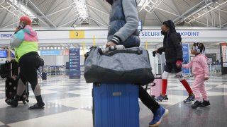 Travelers arrive for flights at O'Hare international Airport