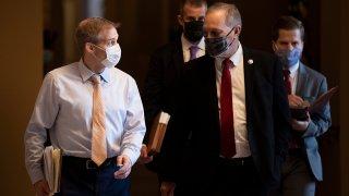 Congresistas Jim Jordan y Andy Biggs.