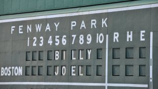 This file photo shows the scoreboard at Fenway Park showing Billy Joel's name.
