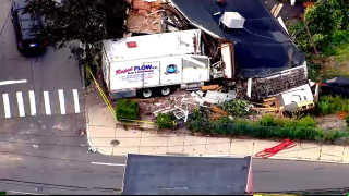 This truck smashed into a Winthrop building before its driver got out and killed two people before police fatally shot him, authorities said.