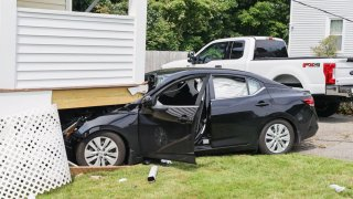 A car crashed into a house in Saugus, Massachusetts, on July 16, 2021.