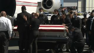 The family of fallen Marine Sgt. Johanny Rosario Pichardo greets her casket at Boston Logan International Airport on Saturday, Sept. 11, 2021.