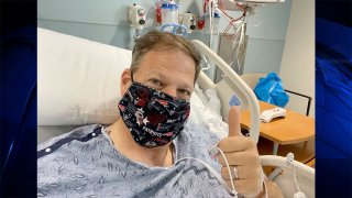 New Hampshire Gov. Chris Sununu at a hospital, where he was diagnosed with an ulcer.