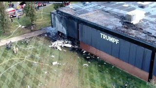 A plane after it crashed into a building in Farmington