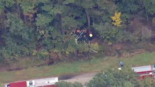Wreckage from a car crash in Hopkinton, Massachusetts, on Thursday, Oct. 7, 2021.