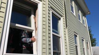 Volunteer contractors replacing windows in Hartford, Connecticut